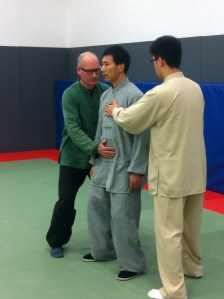 Master Chen illustrates relaxed dantien breathing with Phil and Yiheng