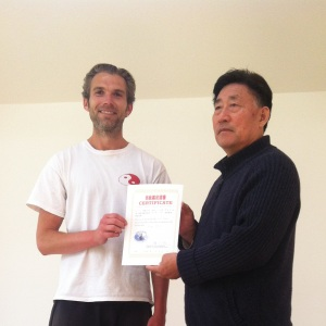 A happy boy with his Xinjia certifcate - Master Chen as usual is as cool as a cucumber